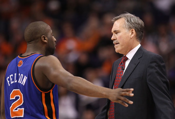 PHOENIX, AZ - JANUARY 07:  Head coach Mike D'Antoni of the New York Knicks talks with Raymond Felton #2 during the NBA game against the Phoenix Suns at US Airways Center on January 7, 2011 in Phoenix, Arizona.  The Knicks defeated the Suns 121-96.  NOTE T