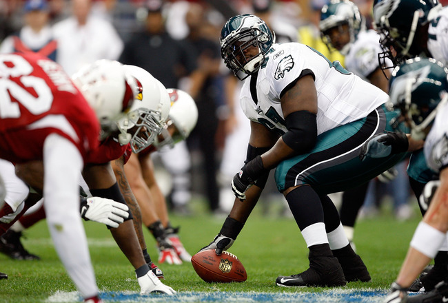 GLENDALE, AZ - JANUARY 18:  Center Jamaal Jackson #67 of the Philadelphia Eagles looks over as he prepares to hike the ball during the NFC championship game against the Arizona Cardinals on January 18, 2009 at University of Phoenix Stadium in Glendale, Ar
