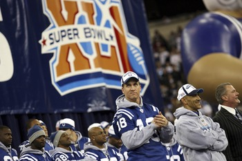 INDIANAPOLIS - FEBRUARY 5:  (R-L) Indianapolis Colts owner Jim Irsay, Head Coach Tony Dungy and Quarterback Peyton Manning lead the celebration of their victory at a rally after the Colts beat the Chicago Bears in Super Bowl XLI Sunday in Miami at the RCA