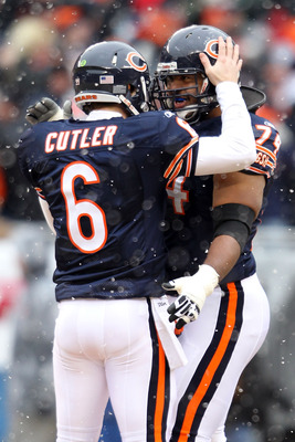 CHICAGO, IL - JANUARY 16:  Quarterback Jay Cutler #6 of the Chicago Bears celebrates his 58-yard touchdown pass in the first quarter with Chris Williams #74 against the Seattle Seahawks in the 2011 NFC divisional playoff game at Soldier Field on January 1