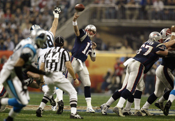 HOUSTON, TX - FEBRUARY 1:  Quarterback Tom Brady #12 of the New England Patriots throws the ball against the Carolina Panthers during Super Bowl XXXVIII at Reliant Stadium on February 1, 2004 in Houston, Texas. The Patriots won 32-29 to claim their second