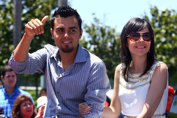 ANAHEIM, CA - JULY 13:  American League All-Star Joakim Soria #48 Kansas City Royals and wife Karla Soria wave to fans during the 6th Annual MLB All-Star Red Carpet Show outside Angel Stadium of Anaheim on July 13, 2010 in Anaheim, California.  (Photo by