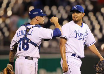 KANSAS CITY, MO - AUGUST 13:  Jason Kendall #18 of the Kansas City Royals congratulates pitcher Joakim Soria #48 after the Royals defeated the New York Yankees 4-3 to win the game on August 13, 2010 at Kauffman Stadium in Kansas City, Missouri.  (Photo by