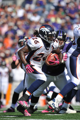 BALTIMORE, MD - OCTOBER 10: Laurence Maroney #26 of the Denver Broncos runs the ball against the Baltimore Ravens at M&T Bank Stadium on October 10, 2010 in Baltimore, Maryland. Players wore pink in recognition of Breast Cancer Awareness Month. The Ravens