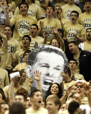 PITTSBURGH, PA - DECEMBER 11:  Pittsburgh Panthers fans hold up a picture of Jamie Dixon's head against the Tennessee Volunteers during the SEC/BIG EAST Invitational at Consol Energy Center on December 11, 2010 in Pittsburgh, Pennsylvania.The Volunteers d