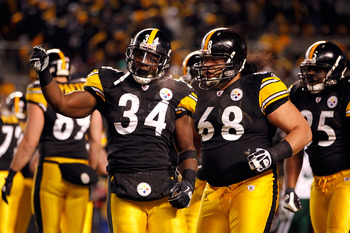 PITTSBURGH, PA - JANUARY 23:  Rashard Mendenhall #34 and Chris Kemoeatu #68 of the Pittsburgh Steelers celebrate Mendenhall's first quarter touchdown against the New York Jets during the 2011 AFC Championship game at Heinz Field on January 23, 2011 in Pit