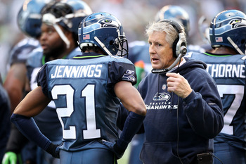 SEATTLE, WA - JANUARY 08:  Head coach Pete Carroll talks with Kelly Jennings #21 of the Seattle Seahawks during their game against the New Orleans Saints during the 2011 NFC wild-card playoff game at Qwest Field on January 8, 2011 in Seattle, Washington.
