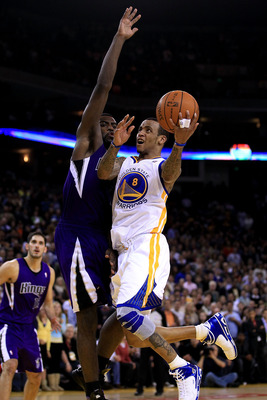 OAKLAND, CA - JANUARY 21:  Monta Ellis #8 of the Golden State Warriors shoots over Tyreke Evans #13 of the Sacramento Kings at Oracle Arena on January 21, 2011 in Oakland, California. NOTE TO USER: User expressly acknowledges and agrees that, by downloadi
