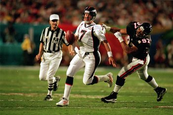 31 Jan 1999:   John Elway #7 of the Denver Broncos is sacked by Cornelius Bennett #97 of the Atlanta Falcons during the Superbowl XXXIII at the Pro Player Stadium in Miami, Florida. The Broncos defeated the Falcons  34-19. Mandatory Credit: Al Bello  /All