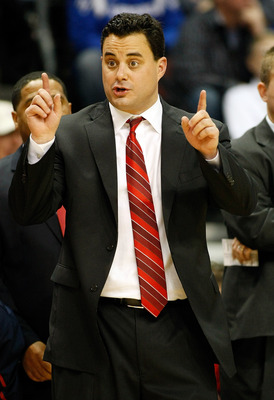LAS VEGAS - NOVEMBER 27:  Head coach Sean Miller of the Arizona Wildcats questions an official during his team's 87-79 loss to the Kansas Jayhawks in the championship game of the Las Vegas Invitational at The Orleans Arena November 27, 2010 in Las Vegas,