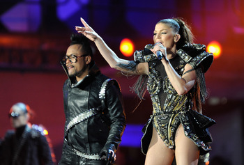 JOHANNESBURG, SOUTH AFRICA - JUNE 10:  Taboo and Fergie of the Black eyed peas performs a song during the kick-off celebration concert for the 2010 FIFA World Cup at the Orlando Stadium on June 10, 2010 in Soweto, South Africa.  (Photo by Stuart Franklin/