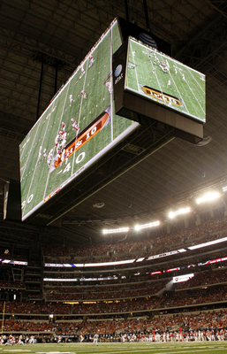 ARLINGTON, TX - DECEMBER 5:  The large television screens are seen over the field during the game between the Texas Longhorns and the Nebraska Cornhuskers at Cowboys Stadium on December 5, 2009 in Arlington, Texas.  (Photo by Ronald Martinez/Getty Images)