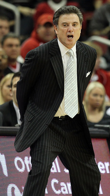 LOUISVILLE, KY - DECEMBER 11:  Rick Pitino the Head Coach of the Louisville Cardinals gives instructions to his team during the game against the UNLV Runnin' Rebels at KFC YUM! Center on December 11, 2010 in Louisville, Kentucky.  (Photo by Andy Lyons/Get