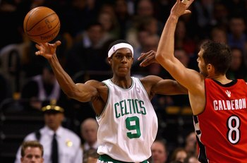 BOSTON - JANUARY 23:  Rajon Rondo #9 of the Boston Celtics passes the ball over Jose Calderon #8 of the Toronto Raptors during the game on January 23, 2008 at the TD Banknorth Garden in Boston, Massachusetts.  The Raptors won 114-112.  NOTE TO USER: User