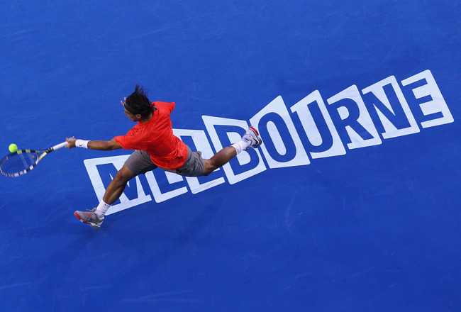 MELBOURNE, AUSTRALIA - JANUARY 24:  Rafael Nadal of Spain stretches for a forehand in his fourth round match against Marin Cilic of Croatia during day eight of the 2011 Australian Open at Melbourne Park on January 24, 2011 in Melbourne, Australia.  (Photo