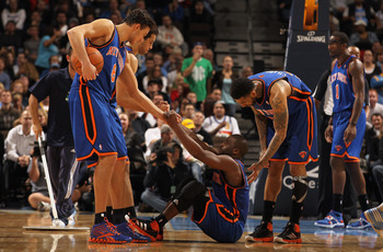 DENVER - NOVEMBER 16:  Raymond Felton #2 of the New York Knicks is helped up by teammates Danilo Gallinari #8, Landry Fields #6 and Wilson Chandler #21 after being fouled as Amar'e Stoudemire #1 looks on against the Denver Nuggets at the Pepsi Center on N