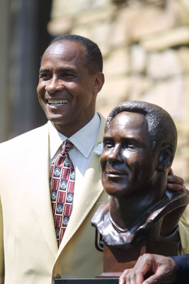 04 Aug 2001 : Lynn Swann poses next to his bust during the 2001 Pro Football Hall Of Fame Induction Ceremony at Hall's Game Day Theater in Canton, Ohio. DIGITAL IMAGE.Mandatory Credit: Tom Pidgeon/Allsport