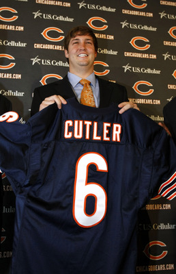 LAKE FOREST, IL - APRIL 3: Quarterback Jay Cutler of the Chicago Bears holds up his #6 jersey after he was introduced as their new quarterback during a press conference on April 3, 2009 at Halas Hall in Lake Forest, Illinois. (Photo by Jim Prisching/Getty