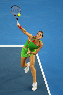 MELBOURNE, AUSTRALIA - JANUARY 23:  Andrea Petkovic of Germany plays a forehand smash in her fourth round match against Maria Sharapova of Russia during day seven of the 2011 Australian Open at Melbourne Park on January 23, 2011 in Melbourne, Australia.