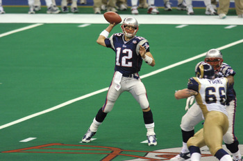 03 Feb 2002:  Quarterback Tom Brady #12 of the New England Patriots winds up to throw a pass against the St.Louis Rams  during Superbowl XXXVI at the Superdome in New Orleans, Louisiana.  The Patriots defeated the Rams 20-17. DIGITAL IMAGE. Mandatory Cred