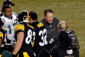 PITTSBURGH, PA - JANUARY 23:  Honorary captain Dennis Byrd of the New York Jets (2ndR) and Braylon Edwards #17 of the New York Jets take part in the coin toss prior to their 2011 AFC Championship game against the Pittsburgh Steelers at Heinz Field on Janu