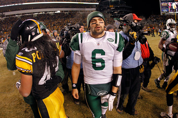PITTSBURGH, PA - JANUARY 23:  Mark Sanchez #6 of the New York Jets leaves the field as Troy Polamalu #43 of the Pittsburgh Steelers looks on after the Pittsburgh Steelers defeated the New York Jets 24 to 19 in their 2011 AFC Championship game at Heinz Fie