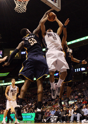 EAST RUTHERFORD, NJ - JANUARY 15:  Courtney Lee #6 of the New Jersey Nets has his shot blocked by Roy Hibbert #55 of the Indiana Pacers at the Izod Center on January 15, 2010 in East Rutherford, New Jersey. NOTE TO USER: User expressly acknowledges and ag