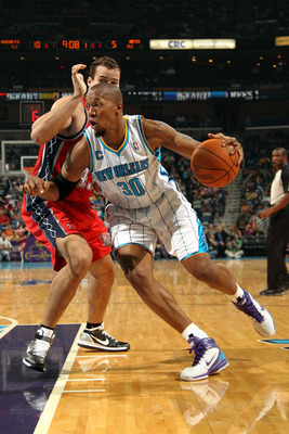 NEW ORLEANS, LA - DECEMBER 22: David West #30  of the New Orleans Hornets drives the ball around Kris Humphries #43 of the New Jersey Nets at the New Orleans Arena on December 22, 2010 in New Orleans, Louisiana.  The Hornets defeated the Nets 105-91.   NO