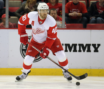 DETROIT, MI - JANUARY 22:  Henrik Zetterberg #40 of the Detroit Red Wings handles the puck in a game against the Chicago Black Hawks on January 22, 2011 at the Joe Louis Arena in Detroit, Michigan. The Hawks defeated the Wings 4-1. (Photo by Claus Anderse