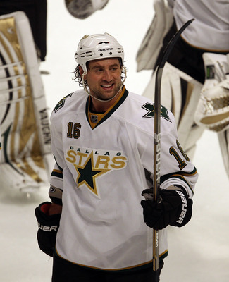 CHICAGO, IL - JANUARY 05: Adam Burish #16 of the Dallas Stars smiles as he leaves the ice after a win over the Chicago Blackhawks at the United Center on January 5, 2011 in Chicago, Illinois. The Stars defeated the Blackhawks 4-2. (Photo by Jonathan Danie