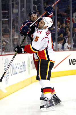 COLUMBUS, OH - OCTOBER 22:  Rick Nash #61 of the Columbus Blue Jackets gets called for high-sticking after hitting Mark Giordano #5 of the Calgary Flames during the second period on October 22, 2010 at Nationwide Arena in Columbus, Ohio.  (Photo by John G