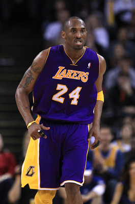 OAKLAND, CA - JANUARY 12: Kobe Bryant #24 of the Los Angeles Lakers runs back on defense during their game against the Golden State Warriors at Oracle Arena on January 12, 2011 in Oakland, California. NOTE TO USER: User expressly acknowledges and agrees t