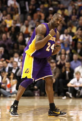 PHOENIX - JANUARY 05: Kobe Bryant #24 of the Los Angeles Lakers pumps his fist after a fould was called against the Phoenix Suns during the NBA game at US Airways Center on January 5, 2011 in Phoenix, Arizona. NOTE TO USER: User expressly acknowledges and