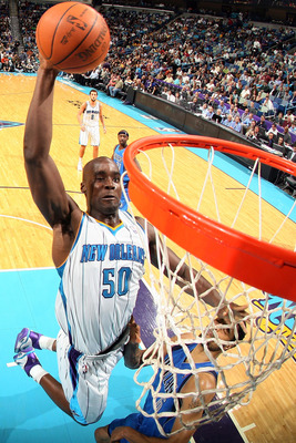 NEW ORLEANS - NOVEMBER 17:  Emeka Okafor #50 of the New Orleans Hornets dunks the ball against the Dallas Mavericks at the New Orleans Arena on November 17, 2010 in New Orleans, Louisiana.  The Hornets defeated the Mavericks 99-97.  NOTE TO USER: User exp