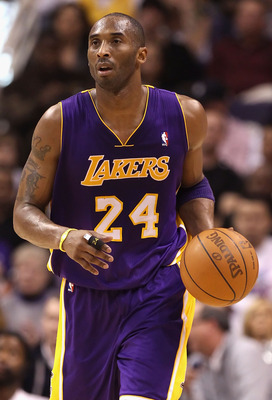 PHOENIX, AZ - JANUARY 05:  Kobe Bryant #24 of the Los Angeles Lakers handles the ball during the NBA game against the Phoenix Suns at US Airways Center on December 23, 2011 in Phoenix, Arizona. The Lakers defeated the Suns 99-95.  NOTE TO USER: User expre