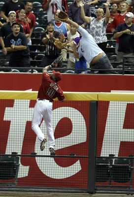 PHOENIX - AUGUST 18:  Outfielder Justin Upton #10 of the Arizona Diamondbacks attempts to catch a home run hit by Jay Bruce (not pictured) of the Cincinnati Reds during the fourth inning of the Major League Baseball game at Chase Field on August 18, 2010