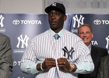 NEW YORK, NY - JANUARY 19:  Rafael Soriano of the New York Yankees tries on his new uniform during his introduction press conference on January 19, 2011 at Yankee Stadium in the Bronx borough of New York City. The Yankees signed Soriano to a three-year co