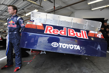 DAYTONA BEACH, FL - JANUARY 21:  Kasey Kahne, driver of the #4 Red Bull Toyota, stands by his car during testing at Daytona International Speedway on January 21, 2011 in Daytona Beach, Florida.  (Photo by Jared C. Tilton/Getty Images for NASCAR)