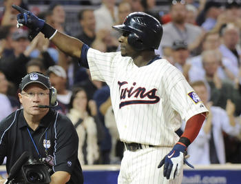 MINNEAPOLIS, MN - OCTOBER 7: Orlando Hudson #1 of the Minnesota Twins celebrates a solo home run in the sixth inning during game two of the ALDS game against the Minnesota Twins on October 7, 2010 at Target Field in Minneapolis, Minnesota.  (Photo by Hann