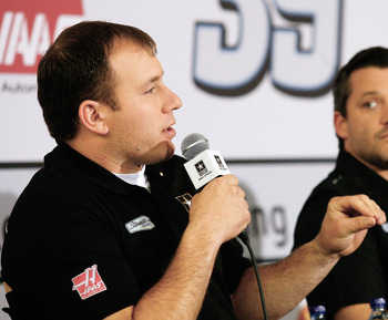CHARLOTTE, NC - JANUARY 24: Ryan Newman (L), driver of the #14 U.S. ARMY Chevrolet, speaks to the media, as Tony Stewart (R), driver of the #14 Office Depot Chevrolet looks on, during the NASCAR Sprint Media Tour hosted by Charlotte Motor Speedway, held a