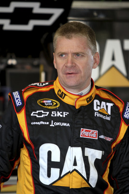 DAYTONA BEACH, FL - JANUARY 20:  Jeff Burton, driver of the #31 Caterpillar Chevrolet waits in the garage during testing at Daytona International Speedway on January 20, 2011 in Daytona Beach, Florida.  (Photo by Jerry Markland/Getty Images for NASCAR)