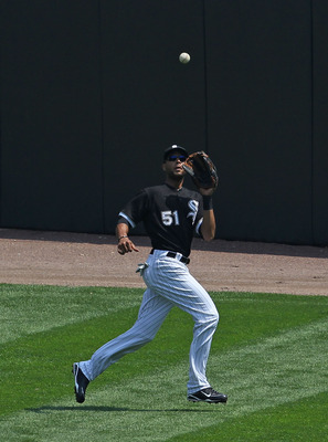 CHICAGO - AUGUST 01: Alex Rios #51 of the Chicago White Sox makes a catch against the Oakland Athletics at U.S. Cellular Field on August 1, 2010 in Chicago, Illinois. The White Sox defeated the Athletics 4-1. (Photo by Jonathan Daniel/Getty Images)