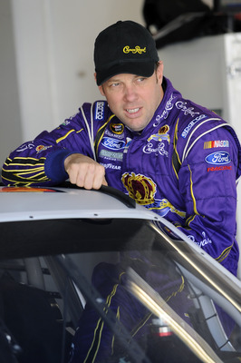 DAYTONA BEACH, FL - JANUARY 22:  Matt Kenseth, driver of the #17 Crown Royal Ford, climbs in his car prior to testing at Daytona International Speedway on January 22, 2011 in Daytona Beach, Florida.  (Photo by Jared C. Tilton/Getty Images for NASCAR)