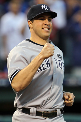ARLINGTON, TX - OCTOBER 15:  Mark Teixeira #25 of the New York Yankees smiles during player introductions against the Texas Rangers in Game One of the ALCS during the 2010 MLB Playoffs at Rangers Ballpark in Arlington on October 15, 2010 in Arlington, Tex