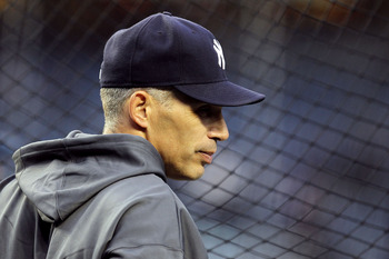 NEW YORK - OCTOBER 18:  Manager Joe Girardi of the New York Yankees looks on during batting practice against the Texas Rangers in Game Three of the ALCS during the 2010 MLB Playoffs at Yankee Stadium on October 18, 2010 in New York, New York.  (Photo by A