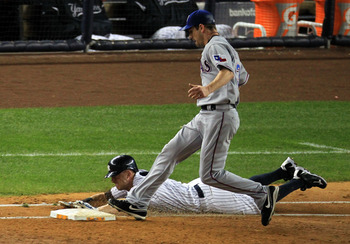 NEW YORK - OCTOBER 18:  Brett Gardner #11 of the New York Yankees is forced out at first base by pitcher Cliff Lee #33 of the Texas Rangers in the bottom of the third inning of Game Three of the ALCS during the 2010 MLB Playoffs at Yankee Stadium on Octob
