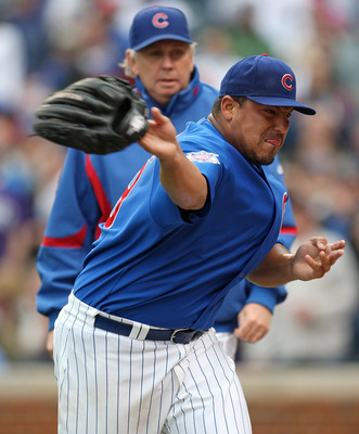 CHICAGO - MAY 27: Starting pitcher Carlos Zambrano #38 of the Chicago Cubs throws his glove into the dugout after being thrown out of a game in the 7th inning against the Pittsburgh Pirates as pitching coach Larry Rothschild watches on May 27, 2009 at Wri