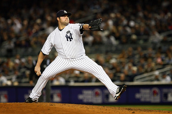 NEW YORK - OCTOBER 19:  Joba Chamberlain #62 of the New York Yankees pitches against the Texas Rangers in Game Four of the ALCS during the 2010 MLB Playoffs at Yankee Stadium on October 19, 2010 in the Bronx borough of New York City.  (Photo by Andrew Bur