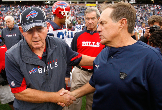 FOXBORO, MA - SEPTEMBER 26:  Coach Bill Belichick of the New England Patriots (R) shakes hands with coach Chan Gailey of the Buffalo Bills after the game at Gillette Stadium on September 26, 2010 in Foxboro, Massachusetts. The Patriots won 38-30. (Photo b