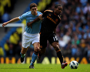 MANCHESTER, ENGLAND - SEPTEMBER 25:  Florent Malouda of Chelsea battles for the ball with Gareth Barry of Manchester City during the Barclays Premier League match between Manchester City and Chelsea at the City of Manchester Stadium on September 25, 2010